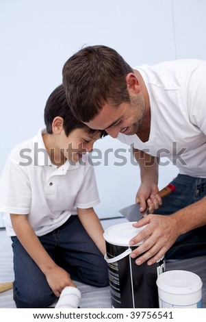 Father and son preparing paint at home