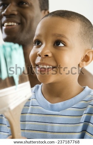 Father and Son Ready to Start Painting - stock photo