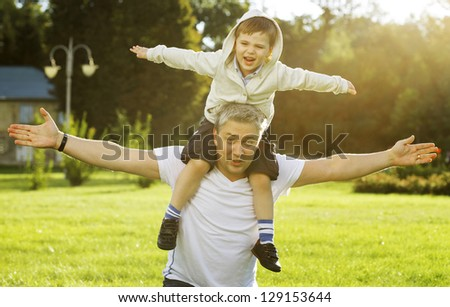 Father and son rest in the summer on the nature - stock photo
