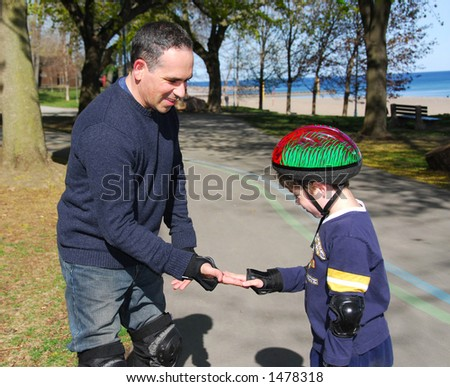 Father and son rollerblading together