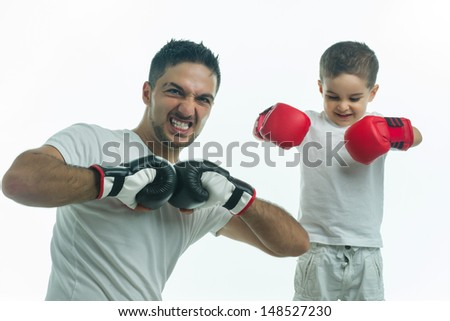 Father and son scaring oppenents - stock photo