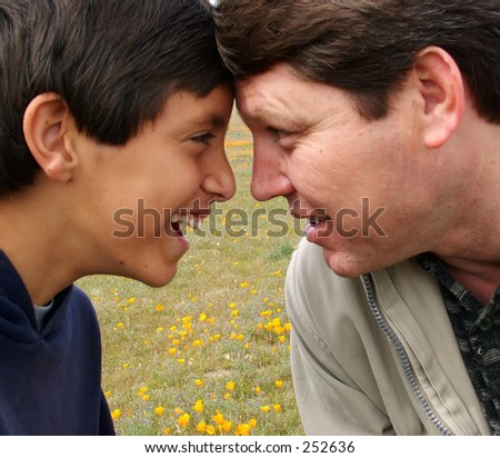 Father and son share a moment at a park