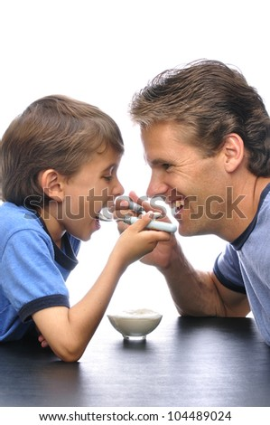 Father and son sharing a bowl of yogurt together with white background