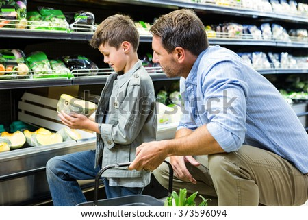 Father and son shopping in the grocery store - stock photo