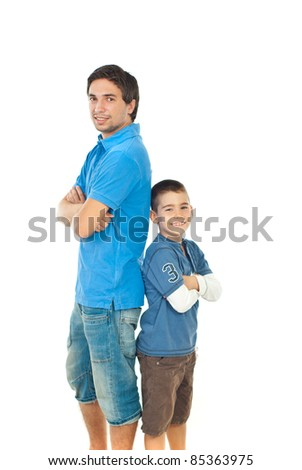 Father and son standing back to back with arms folded isolated on white background - stock photo