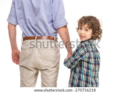 Father and son standing with back to the camera and holding hands,. Boy turn. isolated a white background. - stock photo