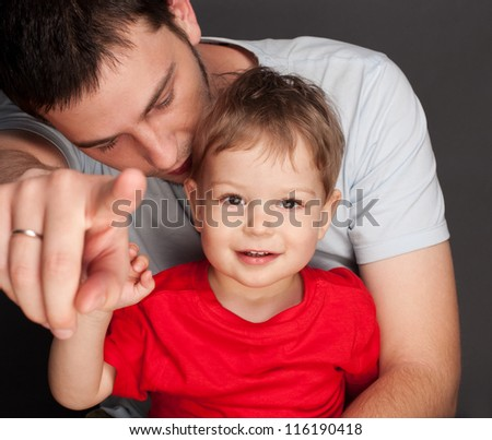 father and son studio shot - stock photo