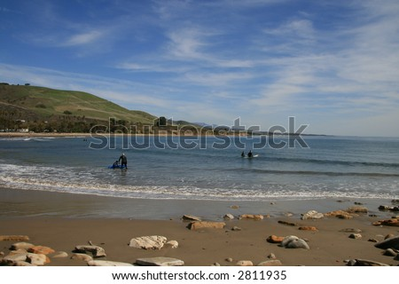 Father and Son Surfing in Southern California - stock photo