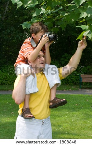 Father and son taking pictures