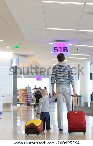 father and son together at the airport - stock photo