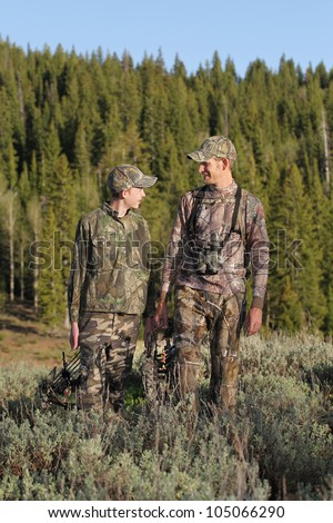 father and son together hunting together - stock photo