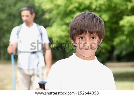 Father and son walking - stock photo