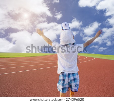 Father and son walking in a sunny day - stock photo