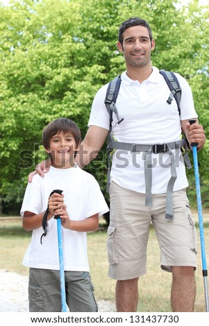 Father and son walking in the countryside - stock photo