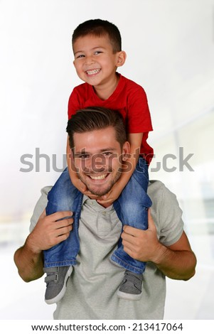 Father and son who are playing together - stock photo