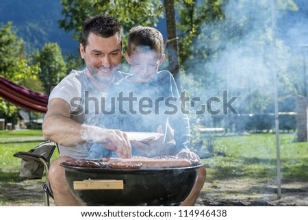 Father and son with barbecue