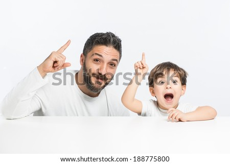 Father and son with creative new ideas - stock photo