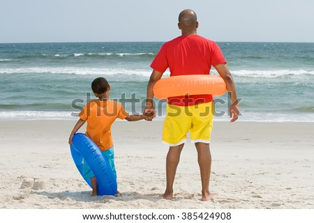 Father and son with inflatable rings - stock photo