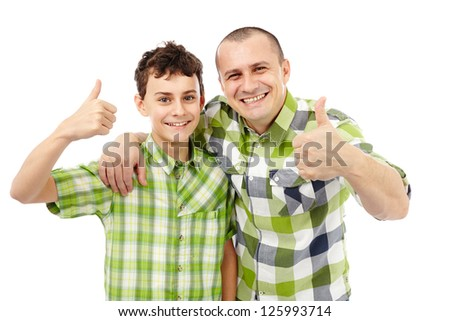 Father and son with thumbs up, isolated on white background - stock photo