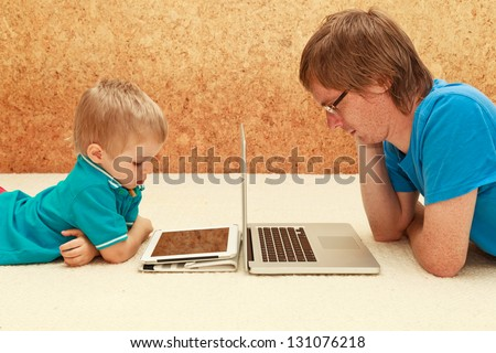 father and son working from home - stock photo