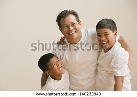 Father and sons playing together
