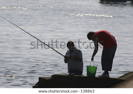 Father and sun fishing - stock photo