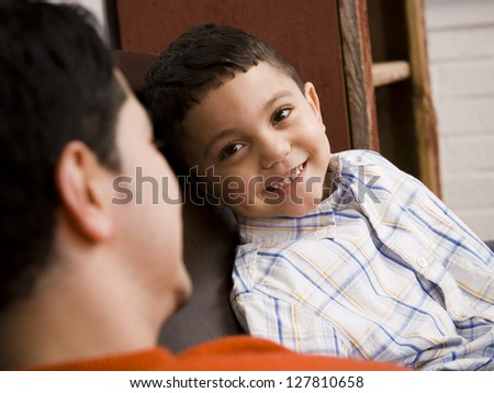 Father and young son talking - stock photo