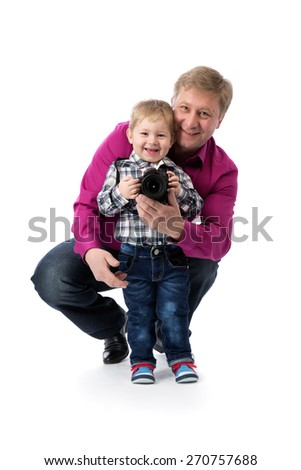 Father and young son with a camera in his hands. Isolate on white.