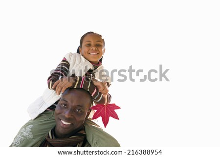 Father carrying daughter on shoulders, smiling, portrait (tilt), cut out