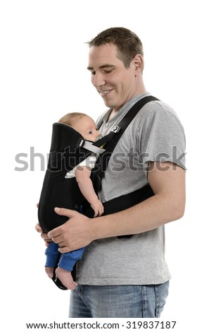 Father carrying his baby in carrier