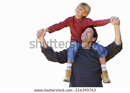 Father carrying son on shoulders, cut out