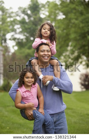 Father carrying two daughters