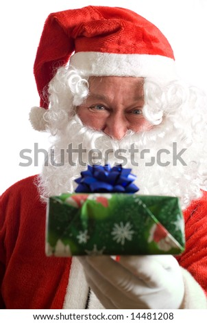 Father Christmas giving a present to you - stock photo