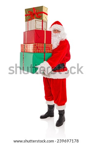 Father Christmas or Santa Claus holding a stack of gift wrapped presents with ribbons and bows, isolated on a white background. - stock photo