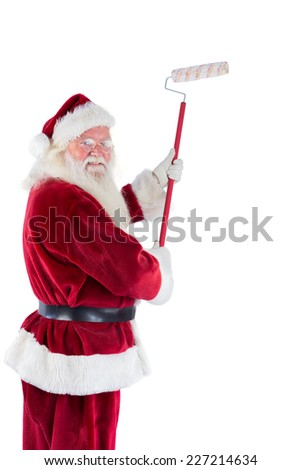 Father Christmas paints a wall away from camera with turned head - stock photo