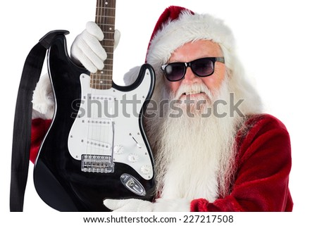 Father Christmas shows a guitar on white background - stock photo