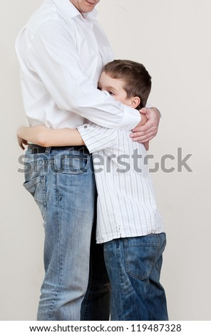 Father comforts a sad child. Problems in the family. Pain - stock photo