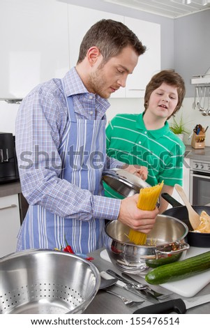Father cooking with his son in the kitchen