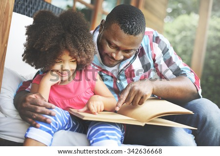 Father Daughter Bonding Cozy Parenting Education Concept - stock photo