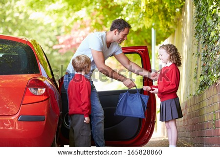 Father Driving To School With Children - stock photo