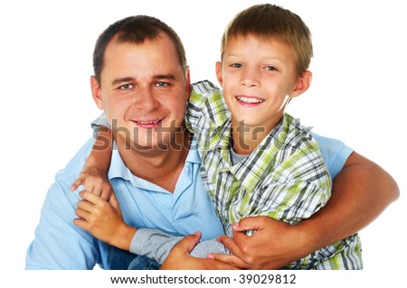 father embracing his son; clouseup faces - stock photo