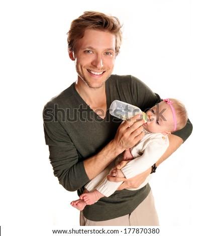 Father feeding his newborn baby - stock photo