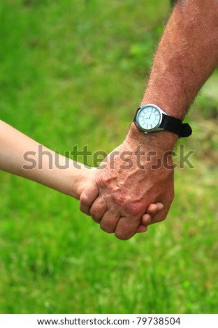 father gives a child a hand - stock photo