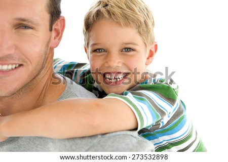 Father giving a piggyback ride to his son. White background. - stock photo