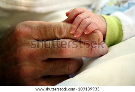 father giving hand to a child closeup