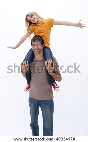 Father giving happy daughter piggy back ride against white background