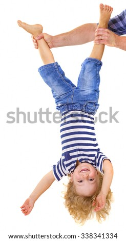 Father hands holding his little son upside down. Trust concept. - stock photo
