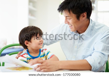 Father Helping Son With Homework - stock photo