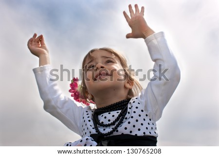 father holding daughter in air like an airplane - stock photo
