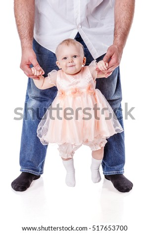 Father holding little  baby girl posing isolated on white